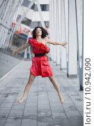 Купить «Woman in red dress jump», фото № 10942090, снято 18 марта 2018 г. (c) PantherMedia / Фотобанк Лори