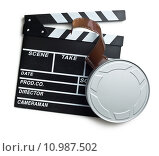 Купить «clapper board with film reel on white background», фото № 10987502, снято 25 апреля 2019 г. (c) PantherMedia / Фотобанк Лори