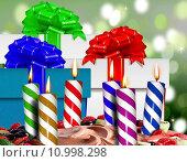 Купить «Birthday candles on a cake and gift boxes», фото № 10998298, снято 22 апреля 2019 г. (c) PantherMedia / Фотобанк Лори