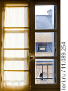 Купить «textile drapes on sunny window», фото № 11089254, снято 20 июля 2019 г. (c) PantherMedia / Фотобанк Лори
