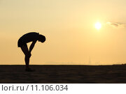 Купить «Silhouette of an exhausted sportsman at sunset», фото № 11106034, снято 26 марта 2019 г. (c) PantherMedia / Фотобанк Лори