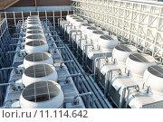 Купить «Cooling tower at roof top», фото № 11114642, снято 27 марта 2019 г. (c) PantherMedia / Фотобанк Лори