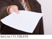 Купить «Businessman holding blank sheet of paper. Business concept.», фото № 11158610, снято 20 июня 2019 г. (c) PantherMedia / Фотобанк Лори