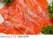 Нарезанная красная рыба с зеленью. Стоковое фото, фотограф Kozub Vasyl / Фотобанк Лори