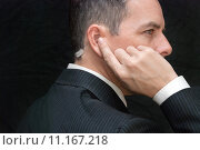 Купить «Secret Service Agent Listens To Earpiece, Side», фото № 11167218, снято 21 октября 2018 г. (c) PantherMedia / Фотобанк Лори
