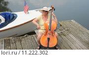 Купить «Mature female cellist.», фото № 11222302, снято 3 июля 2020 г. (c) PantherMedia / Фотобанк Лори