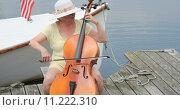 Купить «Mature female cellist.», фото № 11222310, снято 3 июля 2020 г. (c) PantherMedia / Фотобанк Лори