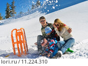 Купить «family having fun on fresh snow at winter vacation», фото № 11224310, снято 17 октября 2019 г. (c) PantherMedia / Фотобанк Лори