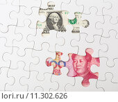 Купить «White puzzle with Chinese yuan and US dollar banknote», фото № 11302626, снято 26 мая 2019 г. (c) PantherMedia / Фотобанк Лори