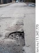 Купить «Very big pothole on the road», фото № 11347770, снято 24 января 2019 г. (c) PantherMedia / Фотобанк Лори