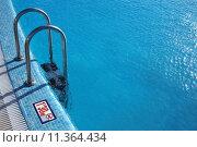 Купить «Swimming pool with steel ladder», фото № 11364434, снято 17 ноября 2018 г. (c) PantherMedia / Фотобанк Лори