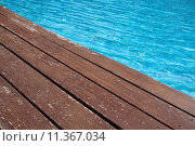Купить «Wooden floor beside swimming pool», фото № 11367034, снято 17 ноября 2018 г. (c) PantherMedia / Фотобанк Лори