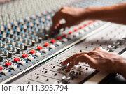 Купить «Editor adjusting the sound mixer», фото № 11395794, снято 21 июня 2018 г. (c) PantherMedia / Фотобанк Лори