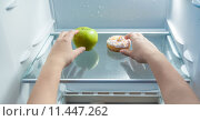 Купить «hands taking green apple and donut from fridge», фото № 11447262, снято 19 апреля 2019 г. (c) PantherMedia / Фотобанк Лори