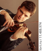 Купить «Man violinist playing violin. Classical music art», фото № 11488974, снято 28 мая 2018 г. (c) PantherMedia / Фотобанк Лори