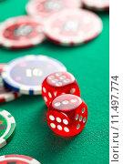 Купить «the red casino dice and casino chips», фото № 11497774, снято 14 июля 2020 г. (c) PantherMedia / Фотобанк Лори
