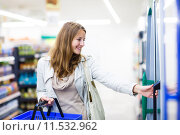 Купить «Beautiful young woman shopping in a grocery store/supermarket (color toned image)», фото № 11532962, снято 22 февраля 2019 г. (c) PantherMedia / Фотобанк Лори