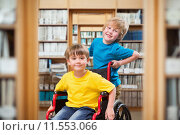 Купить «Composite image of happy boy pushing friend on wheelchair», фото № 11553066, снято 22 октября 2018 г. (c) Wavebreak Media / Фотобанк Лори