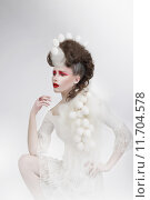 Купить «Stylization. Woman with Eggshells and Art Fancy Makeup. Fantasy», иллюстрация № 11704578 (c) PantherMedia / Фотобанк Лори