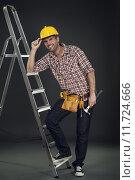 Купить «Manual worker leaning on the ladder», фото № 11724666, снято 21 марта 2019 г. (c) PantherMedia / Фотобанк Лори