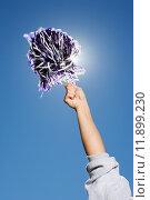 Купить «Arm of a cheerleader holding pom-pom», фото № 11899230, снято 21 июля 2019 г. (c) PantherMedia / Фотобанк Лори
