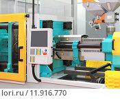 Купить «Injection moulding machine», фото № 11916770, снято 20 августа 2018 г. (c) PantherMedia / Фотобанк Лори