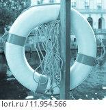Купить «Life buoy on a river over blurred urban background - cool cyanotype», фото № 11954566, снято 21 марта 2019 г. (c) PantherMedia / Фотобанк Лори