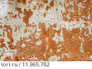Купить «Concrete surface with the remains of whitewash and orange paint», фото № 11965782, снято 16 октября 2018 г. (c) PantherMedia / Фотобанк Лори