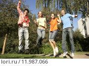 Купить «Teenagers jumping in a park.», фото № 11987066, снято 21 марта 2019 г. (c) PantherMedia / Фотобанк Лори