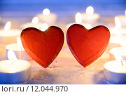 Купить «small red wooden hearts and candles», фото № 12044970, снято 16 октября 2018 г. (c) PantherMedia / Фотобанк Лори