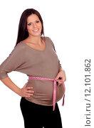 Купить «Pregnant woman measuring her belly», фото № 12101862, снято 21 января 2019 г. (c) PantherMedia / Фотобанк Лори