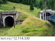Купить «Two tunnels in the Carpathians with entering train», фото № 12114330, снято 23 марта 2019 г. (c) PantherMedia / Фотобанк Лори