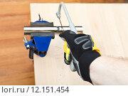 Купить «plumber sawing plumbing drain pipe gripped in vice», фото № 12151454, снято 16 июля 2019 г. (c) PantherMedia / Фотобанк Лори