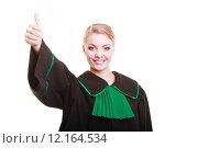 Купить «Young female lawyer attorney wearing classic polish black green gown», фото № 12164534, снято 6 июля 2020 г. (c) PantherMedia / Фотобанк Лори