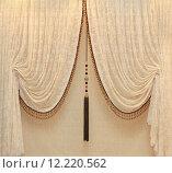 Купить «Vintage drapes with gold embellishments hanging from a wall», фото № 12220562, снято 20 июля 2019 г. (c) PantherMedia / Фотобанк Лори