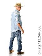 Купить «Trendy young man with jeans, denim shirt and straw hat», фото № 12244506, снято 19 июля 2019 г. (c) PantherMedia / Фотобанк Лори