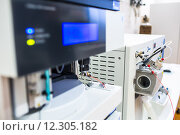 Купить «Chemistry lab Detail of a machine/chromatograph (shallow DOF;  color toned image)», фото № 12305182, снято 21 сентября 2018 г. (c) PantherMedia / Фотобанк Лори
