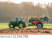Купить «Tractor on a field with ferilizer», фото № 12314758, снято 22 мая 2019 г. (c) PantherMedia / Фотобанк Лори