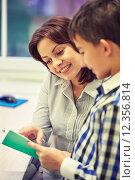 Купить «school boy with notebook and teacher in classroom», фото № 12356814, снято 15 ноября 2014 г. (c) Syda Productions / Фотобанк Лори