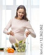Купить «happy pregnant woman preparing food at home», фото № 12362062, снято 10 февраля 2015 г. (c) Syda Productions / Фотобанк Лори