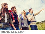 Купить «group of smiling friends with backpacks hiking», фото № 12375354, снято 31 августа 2014 г. (c) Syda Productions / Фотобанк Лори