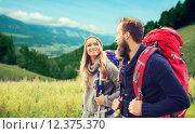 Купить «smiling couple with backpacks hiking», фото № 12375370, снято 31 августа 2014 г. (c) Syda Productions / Фотобанк Лори