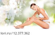 Купить «beautiful woman in cotton underwear touching legs», фото № 12377362, снято 25 июля 2013 г. (c) Syda Productions / Фотобанк Лори