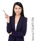 Купить «Asian businesswoman with pen point up», фото № 12417774, снято 18 июня 2019 г. (c) PantherMedia / Фотобанк Лори