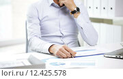 Купить «busy businessman with laptop and papers in office», видеоролик № 12425578, снято 8 июля 2015 г. (c) Syda Productions / Фотобанк Лори