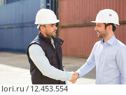 Купить «Docker and supervisor handshaking in front of containers», фото № 12453554, снято 17 октября 2018 г. (c) PantherMedia / Фотобанк Лори