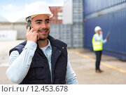 Купить «Young Attractive docker using mobile phone at work», фото № 12453678, снято 17 октября 2018 г. (c) PantherMedia / Фотобанк Лори