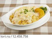 Купить «Shrimp and rice severed covered with a delicious sauce», фото № 12458758, снято 21 мая 2018 г. (c) PantherMedia / Фотобанк Лори