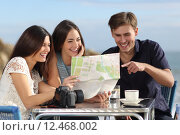 Купить «Group of young tourist friends consulting a paper map», фото № 12468002, снято 23 июля 2019 г. (c) PantherMedia / Фотобанк Лори