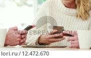 Купить «Hipsters using their smartphones together», видеоролик № 12472670, снято 19 августа 2019 г. (c) Wavebreak Media / Фотобанк Лори
